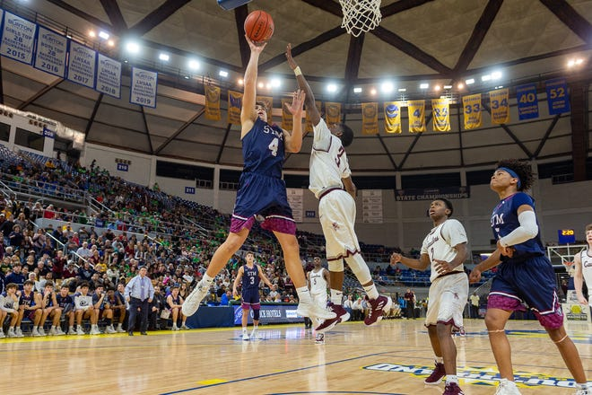 Jack Bech takes a shot as The STM Cougars beat DeLaSalle in double overtime to win the Allstate Sugar Bowl/LHSAA Boys' Marsh Madness Div II State Championship. Saturday, March 9, 2019.