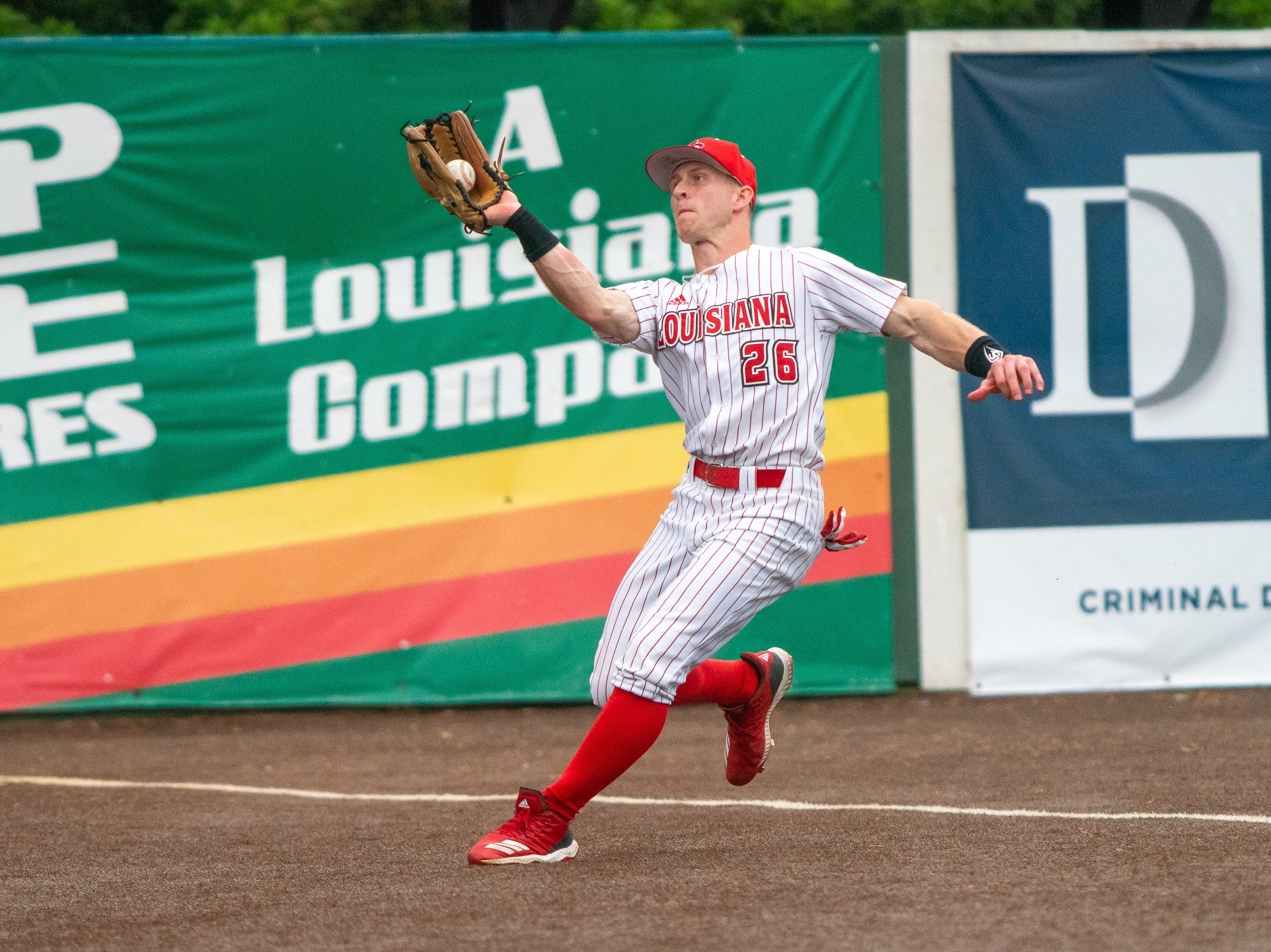 UL's Daniel Lahare makes a catch in the outfield as the Ragin' Cajuns take on the Loyola Marymount Lions at M.L. Tigue Moore Field on March 10, 2019.