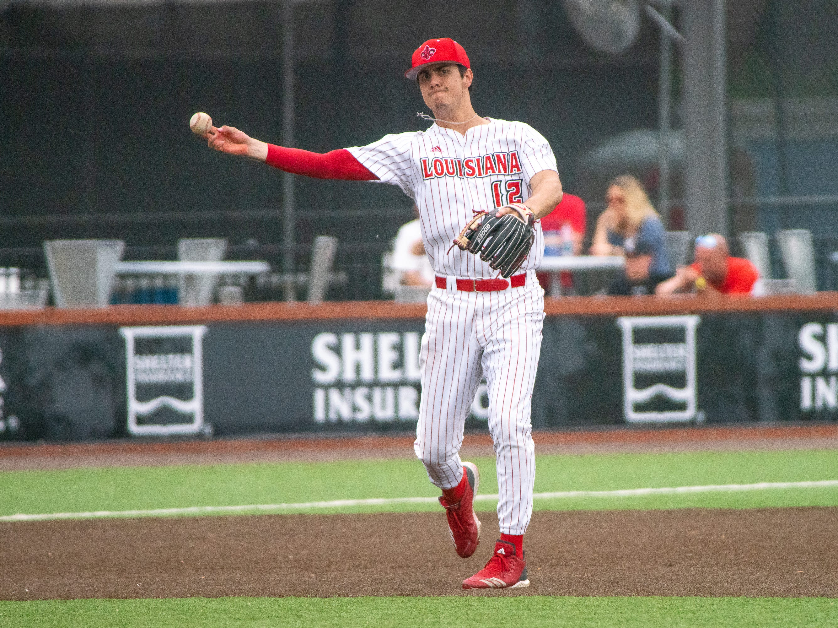 UL's Jonathan Windham practices on the field in between innings as the Ragin' Cajuns take on the Loyola Marymount Lions at M.L. Tigue Moore Field on March 10, 2019.