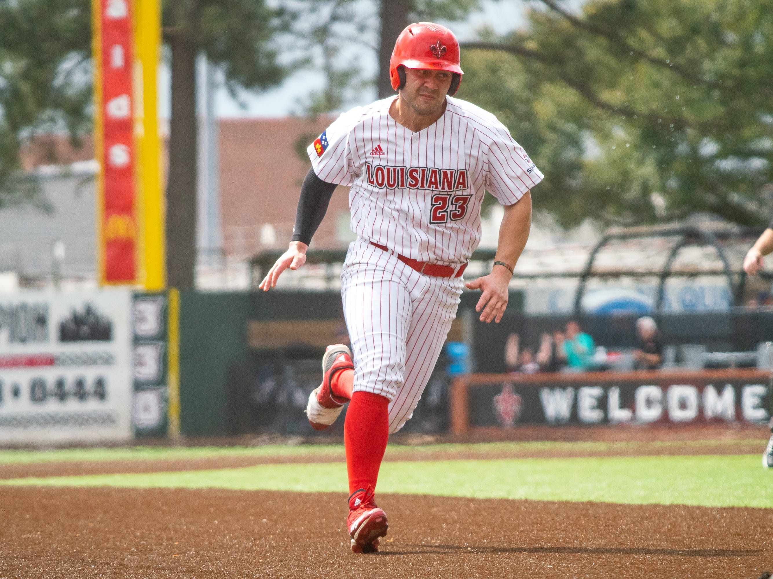 UL's Handsome Monica sprints to third base as the Ragin' Cajuns take on the Loyola Marymount Lions at M.L. Tigue Moore Field on March 10, 2019.