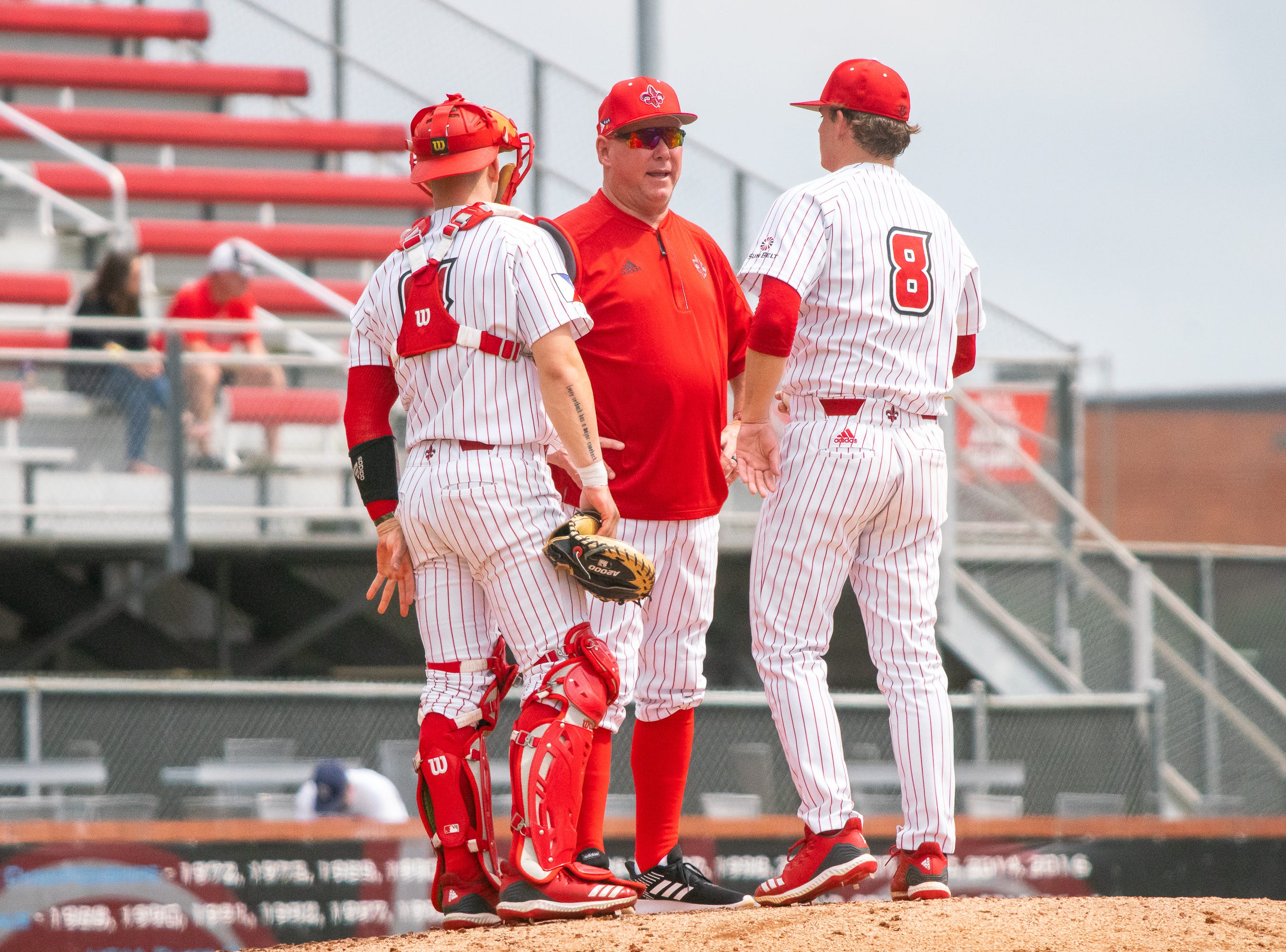 UL's head baseball coach Tony Robichaux talks to pitcher Blake Schultz on the mound as the Ragin' Cajuns take on the Loyola Marymount Lions at M.L. Tigue Moore Field on March 10, 2019.