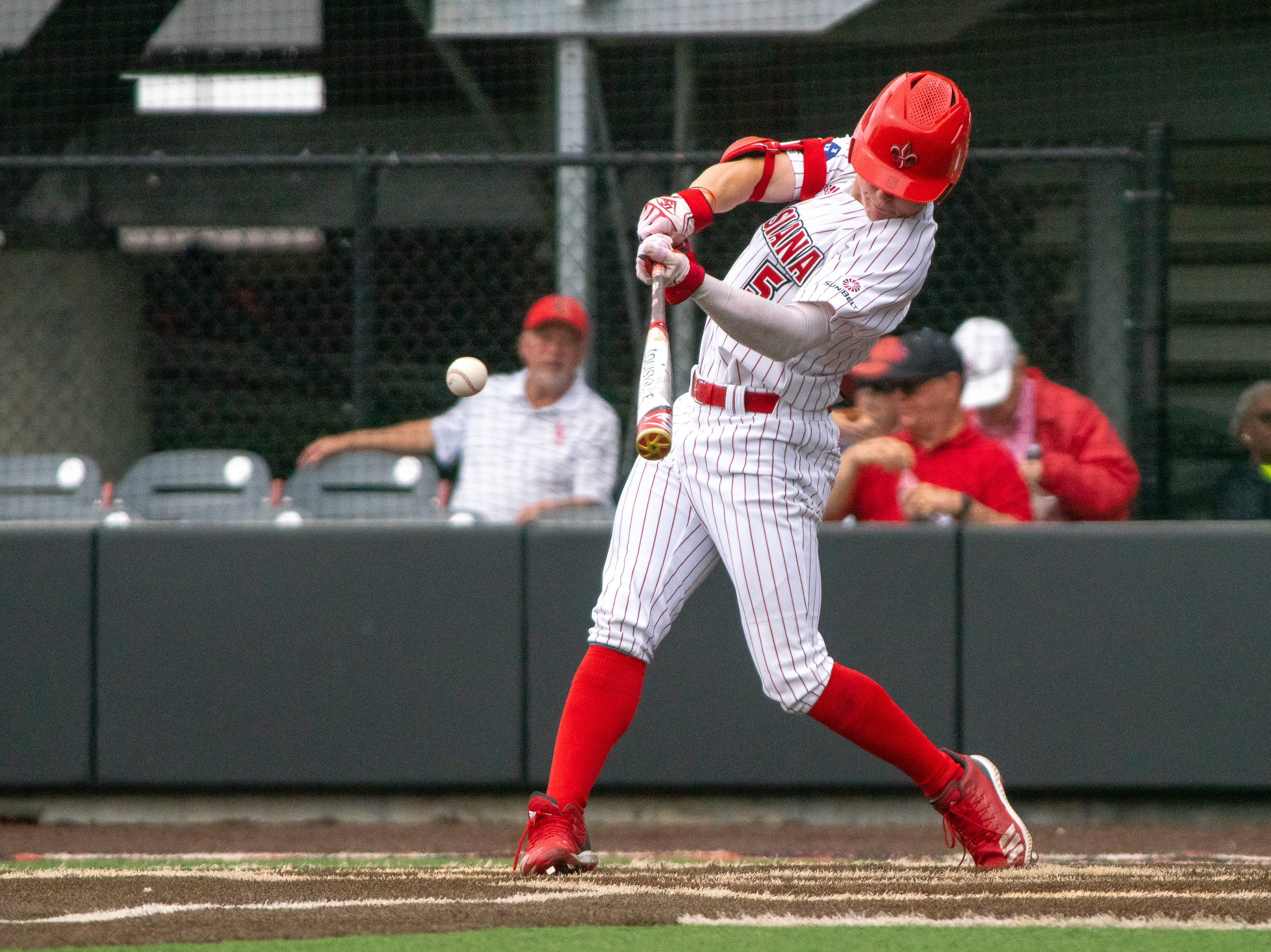 UL's Hayden Cantrelle hits the incoming pitch as the Ragin' Cajuns take on the Loyola Marymount Lions at M.L. Tigue Moore Field on March 10, 2019.