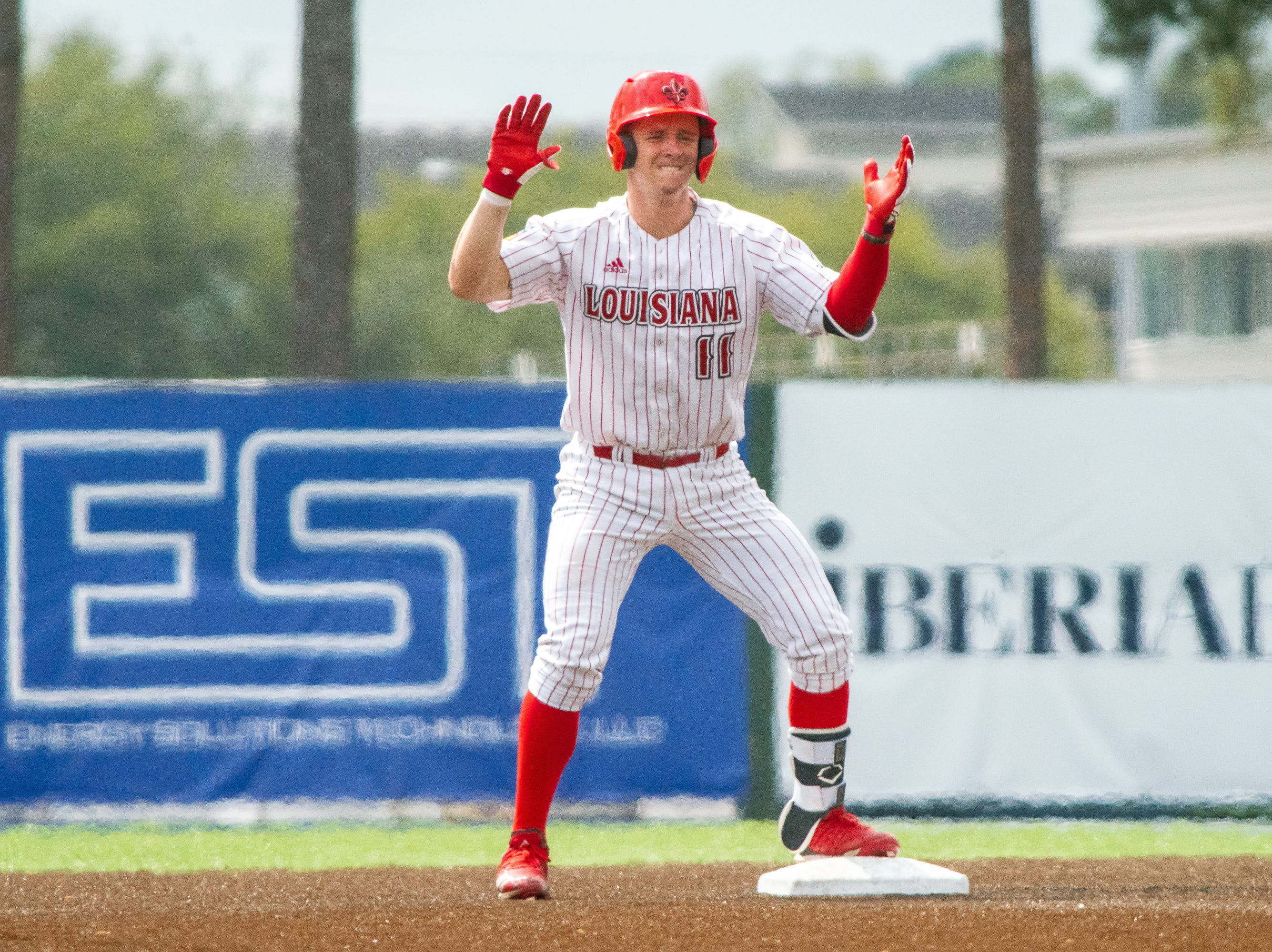 UL's Kole McKinnon celebrates on second base after his successful at-bat as the Ragin' Cajuns take on the Loyola Marymount Lions at M.L. Tigue Moore Field on March 10, 2019.