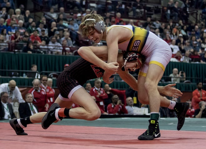 Lancaster's Logan Agin wrestling in last year's Division I 113-pound state championship match. He fell 3-2 to finish as state runner-up. He had high hopes of winning a state title this year, but the state tournament has been postponed. Agin has a career record of 171-11.