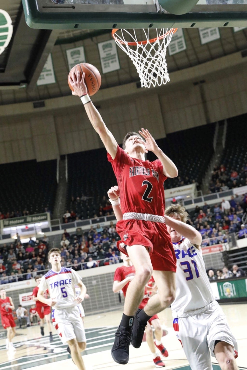 Fairfield Union senior guard Evan Conley goes in for two of his 20 points against Zane Trace in a Southeast District Division II final Sunday at Ohio University's Convocation Center. The Falcons lost, 51-45.