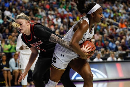 Louisville Cardinals forward Sam Fuehring (3) defends against Notre Dame Fighting Irish guard Jackie Young (5) during the first half in the women's ACC Conference Tournament at Greensboro Coliseum in Greensboro, North Carolina, on Sunday, March 10, 2019.