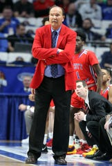 Scott County head coach Billy Hicks watches his team during the championship game of the KHSAA Sweet 16 against Trinity in Lexington, Sunday, March 10, 2019. Trinity won 50-40.