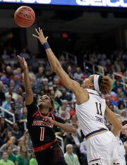 Louisville's Dana Evans (1) shoots against Notre Dame's Brianna Turner (11) during the first half of an NCAA college basketball game in the championship of the Atlantic Coast Conference women's tournament in Greensboro, N.C., Sunday, March 10, 2019.
