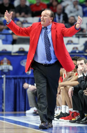 Scott County head coach Billy Hicks reacts to a call during the championship game against Trinity in the KHSAA Sweet 16 in Lexington, Sunday, March 10, 2019. Trinity won 50-40.