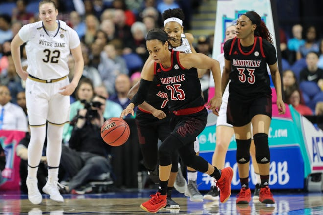 Louisville Cardinals guard Asia Durr (25) dribbles up court after a steal against the Notre Dame Fighting Irish during the first half in the women's ACC Conference Tournament at Greensboro Coliseum in Greensboro, North Carolina, on Sunday, March 10, 2019.