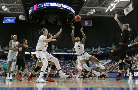 Notre Dame's Jackie Young (5) shoots against Louisville during the first half of an NCAA college basketball game in the championship of the Atlantic Coast Conference women's tournament in Greensboro, N.C., Sunday, March 10, 2019.