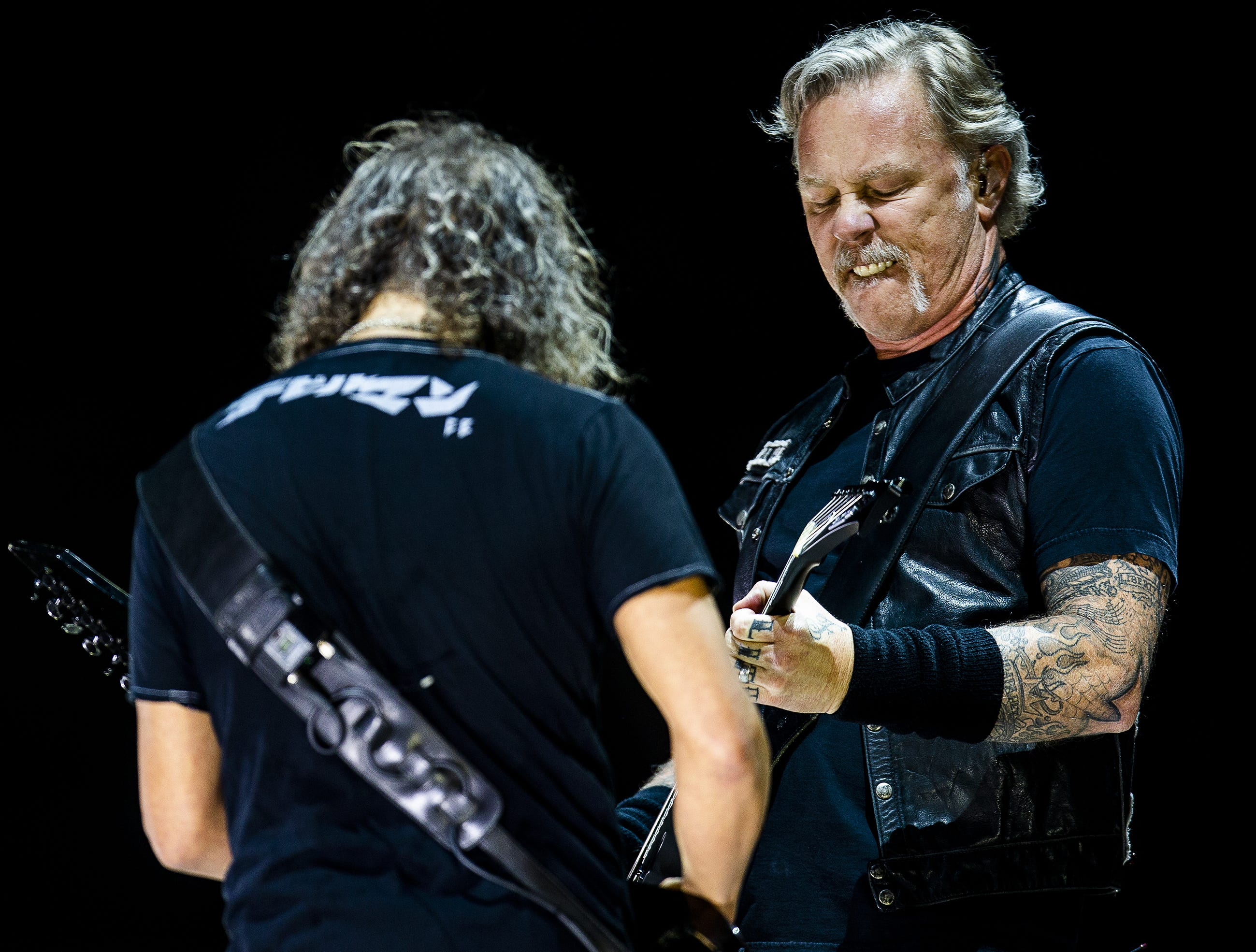 Metallica bandmates James Hetfield and Kirk Hammett stood together while performing at the KFC Yum Center in downtown Louisville, Ky. on Saturday, March 9, 2019.