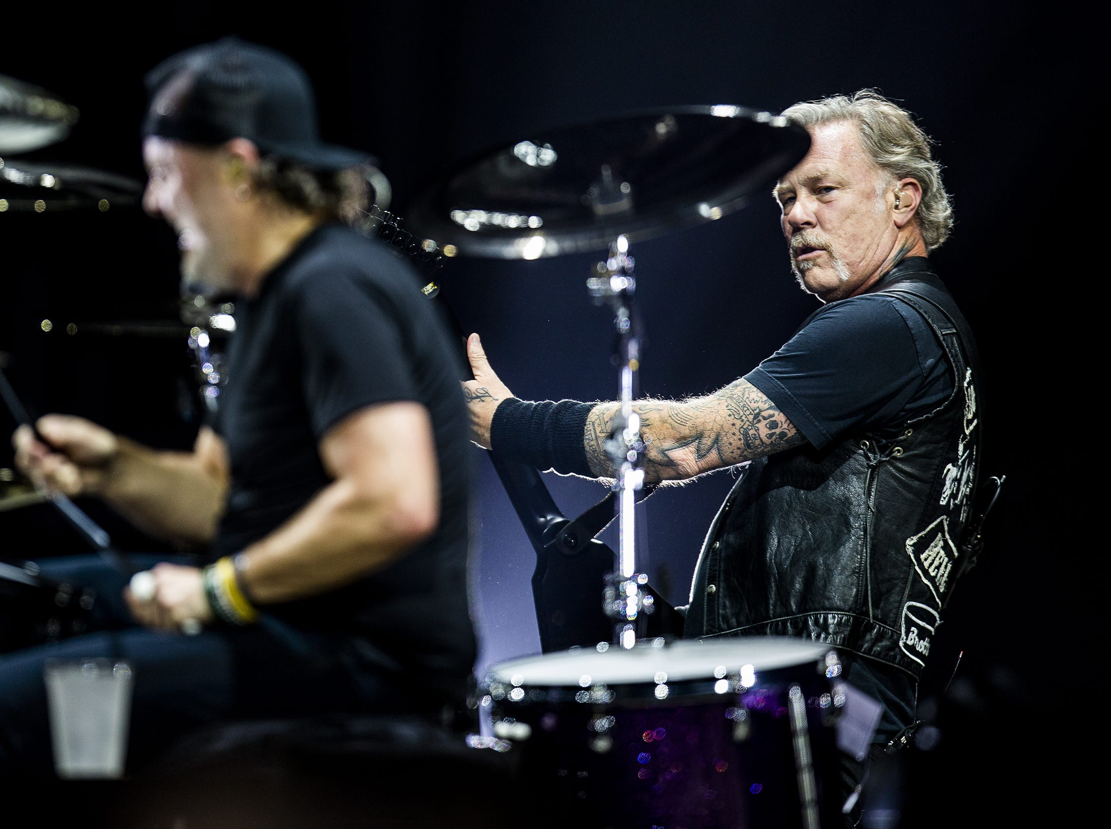 James Hetfield looked over at Lars Ulrich as they performed at the KFC Yum Center in downtown Louisville, Ky. on Saturday, March 9, 2019.
