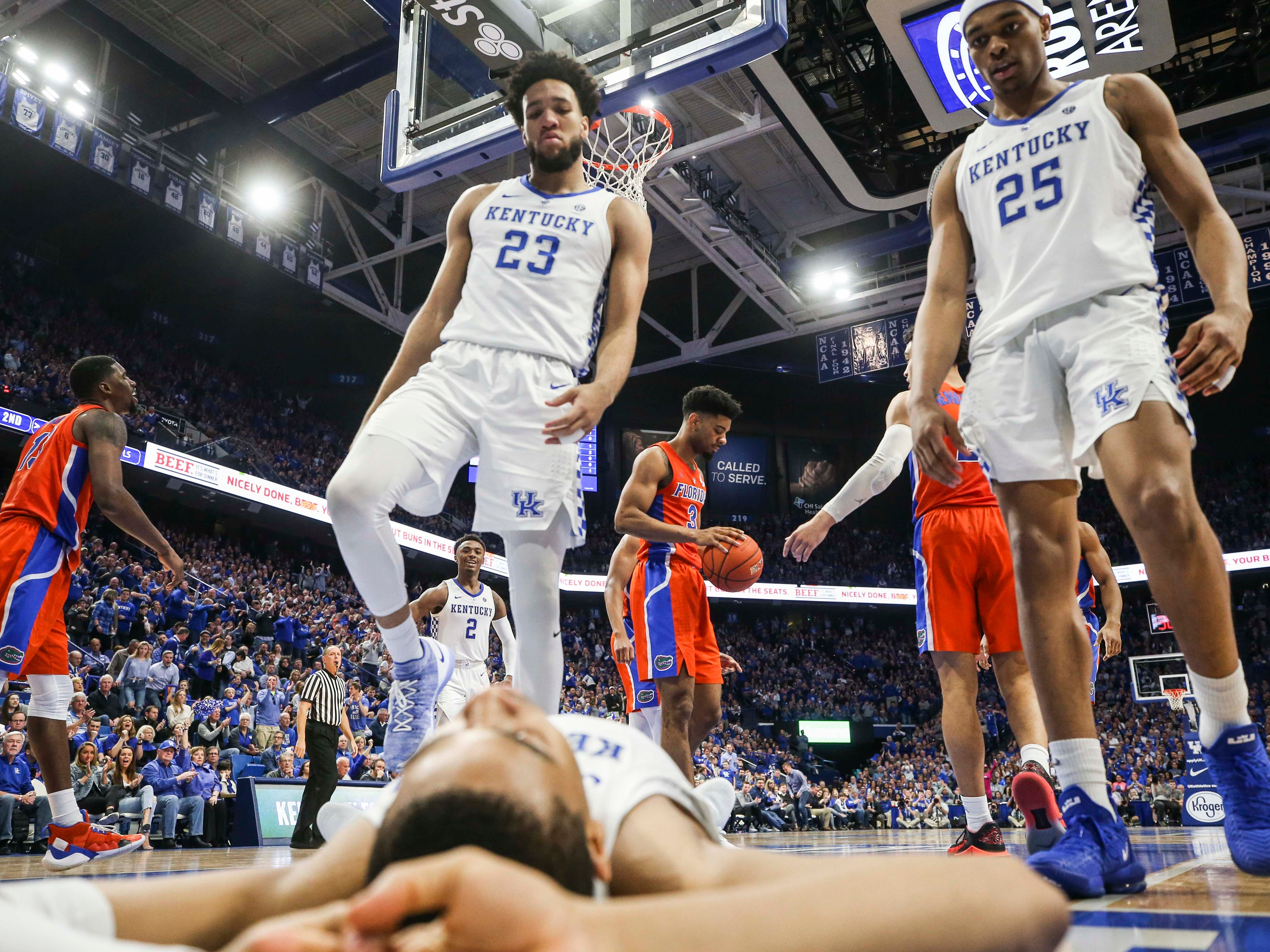 Kentucky's EJ Montgomery and PJ Washington help Keldon Johnson from the floor during the win against Florida. March 9, 2019