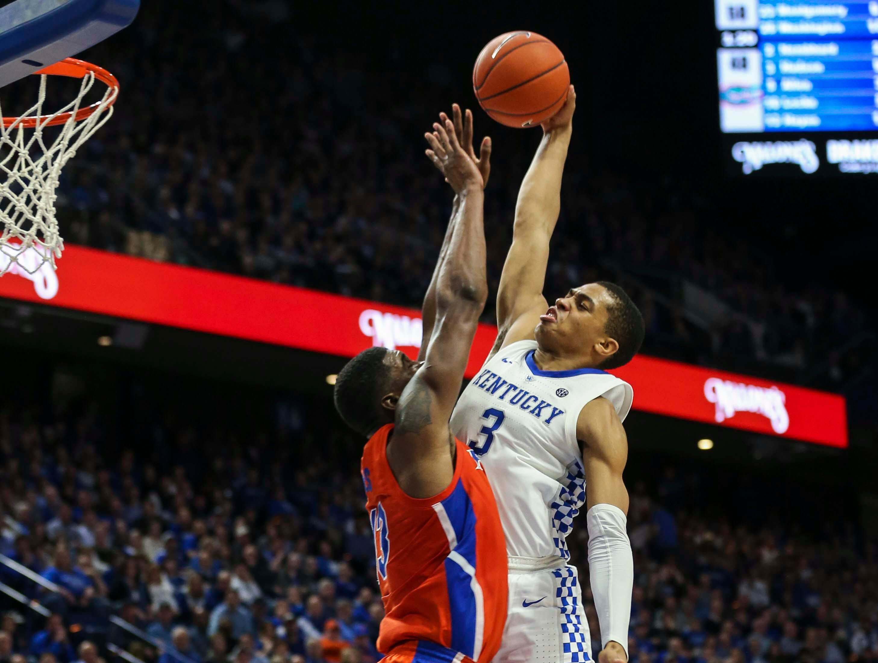 Kentucky's Keldon Johnson soared as he attempted a basket in the game against Florida. Johnson finished with 14 points and seven rebounds. March 9, 2019