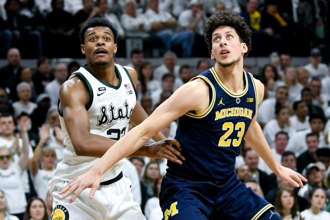 Former East Lansing High School standout Michigan's Brandon Johns Jr., right, and Michigan State's Xavier Tillman battle for position during the first half on Saturday, March 9, 2019, at the Breslin Center in East Lansing.