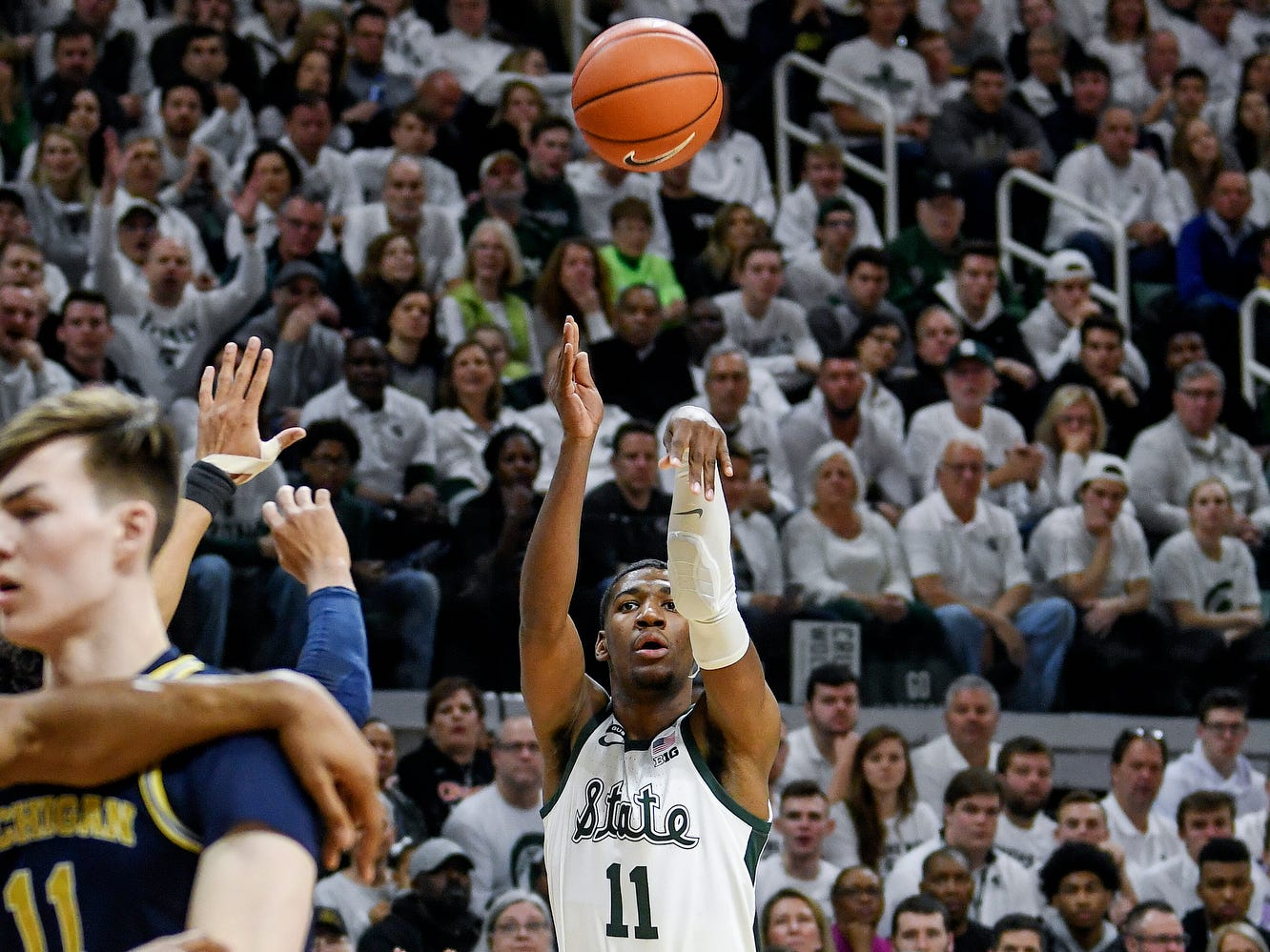 Michigan State's Aaron Henry makes a 3-pointer during the first half of the Spartans game against Michigan on Saturday, March 9, 2019, at the Breslin Center in East Lansing.