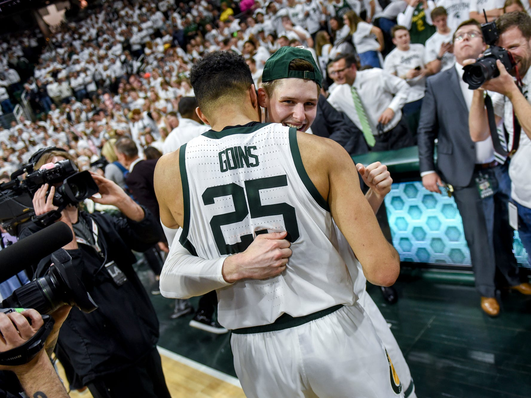 Michigan State senior Matt McQuaid, right, hugs fellow senior Kenny Goins after defeating Michigan 75-63 on Saturday, March 9, 2019, at the Breslin Center in East Lansing.