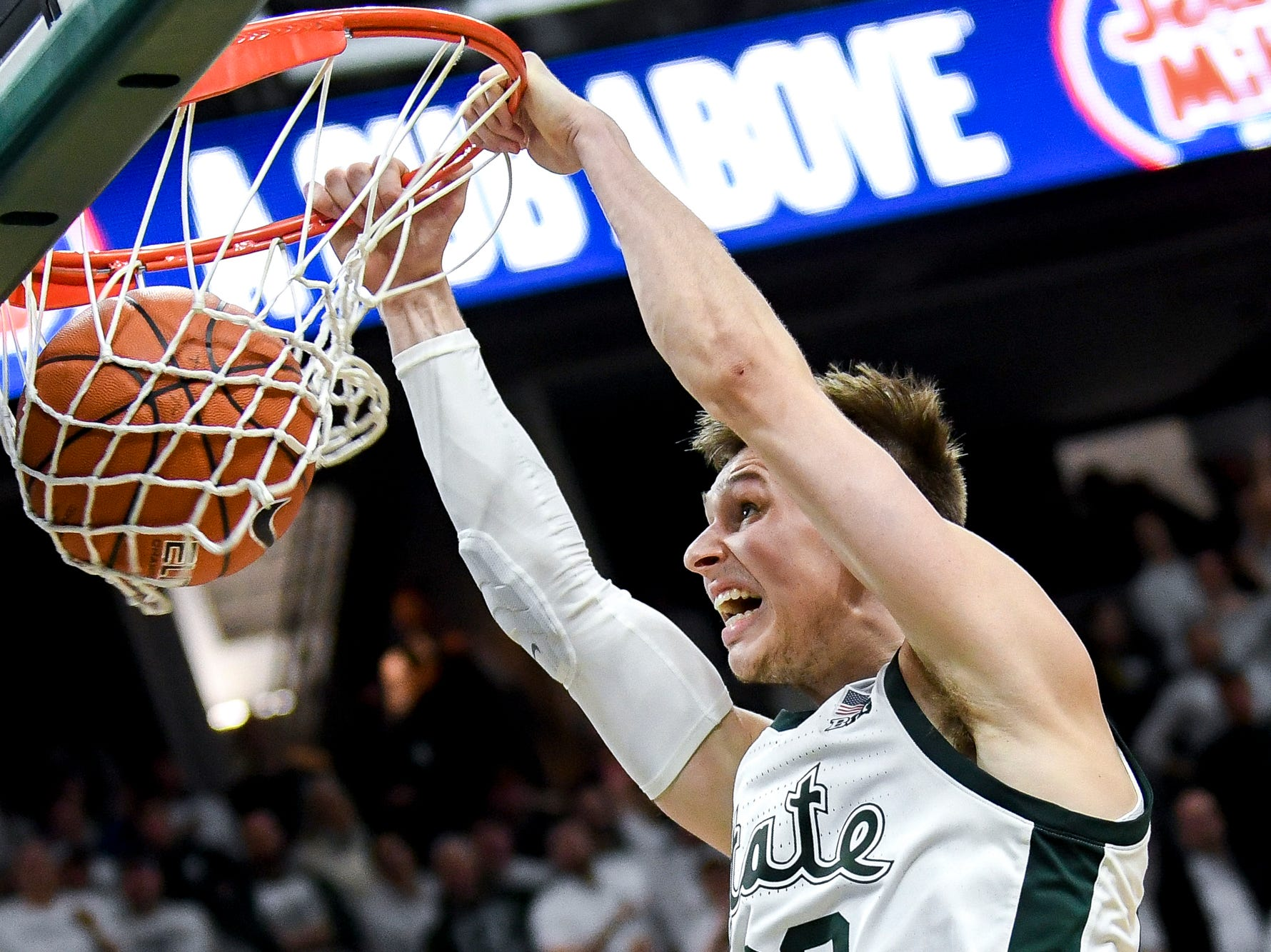 Michigan State's Matt McQuaid dunks during the second half on Saturday, March 9, 2019, at the Breslin Center in East Lansing.