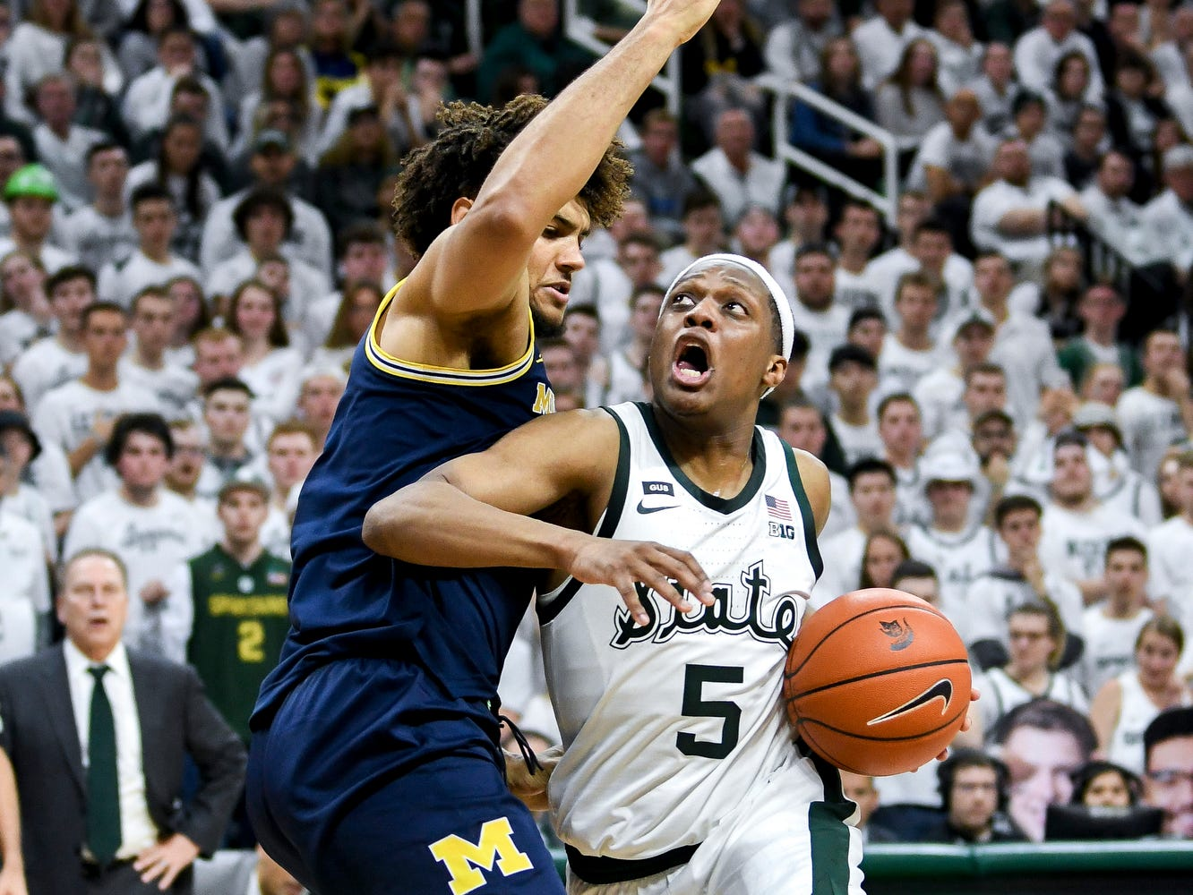 Michigan State's Cassius Winston, right, moves past Michigan's Isaiah Livers during the second half on Saturday, March 9, 2019, at the Breslin Center in East Lansing.
