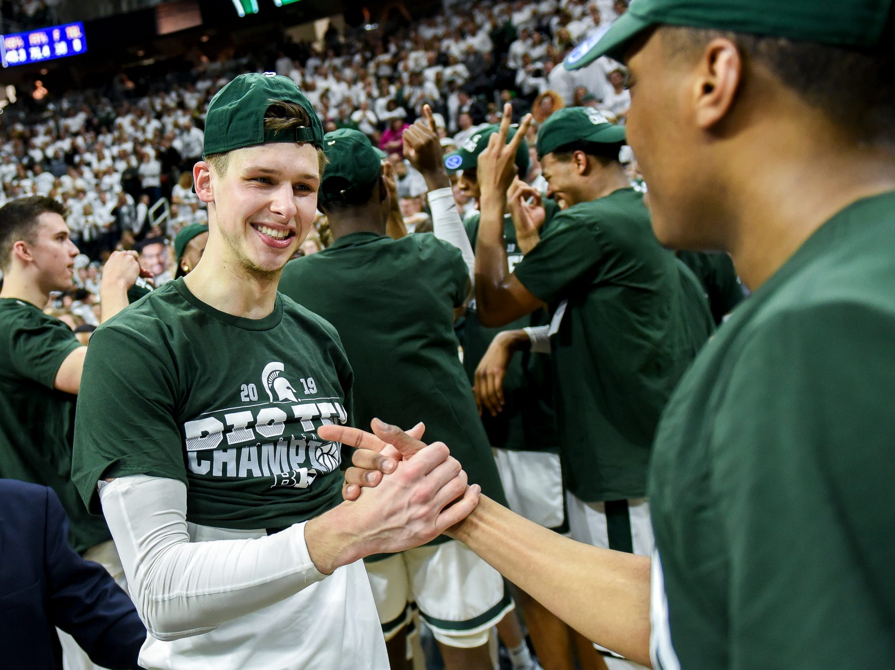 Michigan State's Matt McQuaid, left, and Cassius Winston celebrate after beating Michigan 75-63 on Saturday, March 9, 2019, at the Breslin Center in East Lansing.
