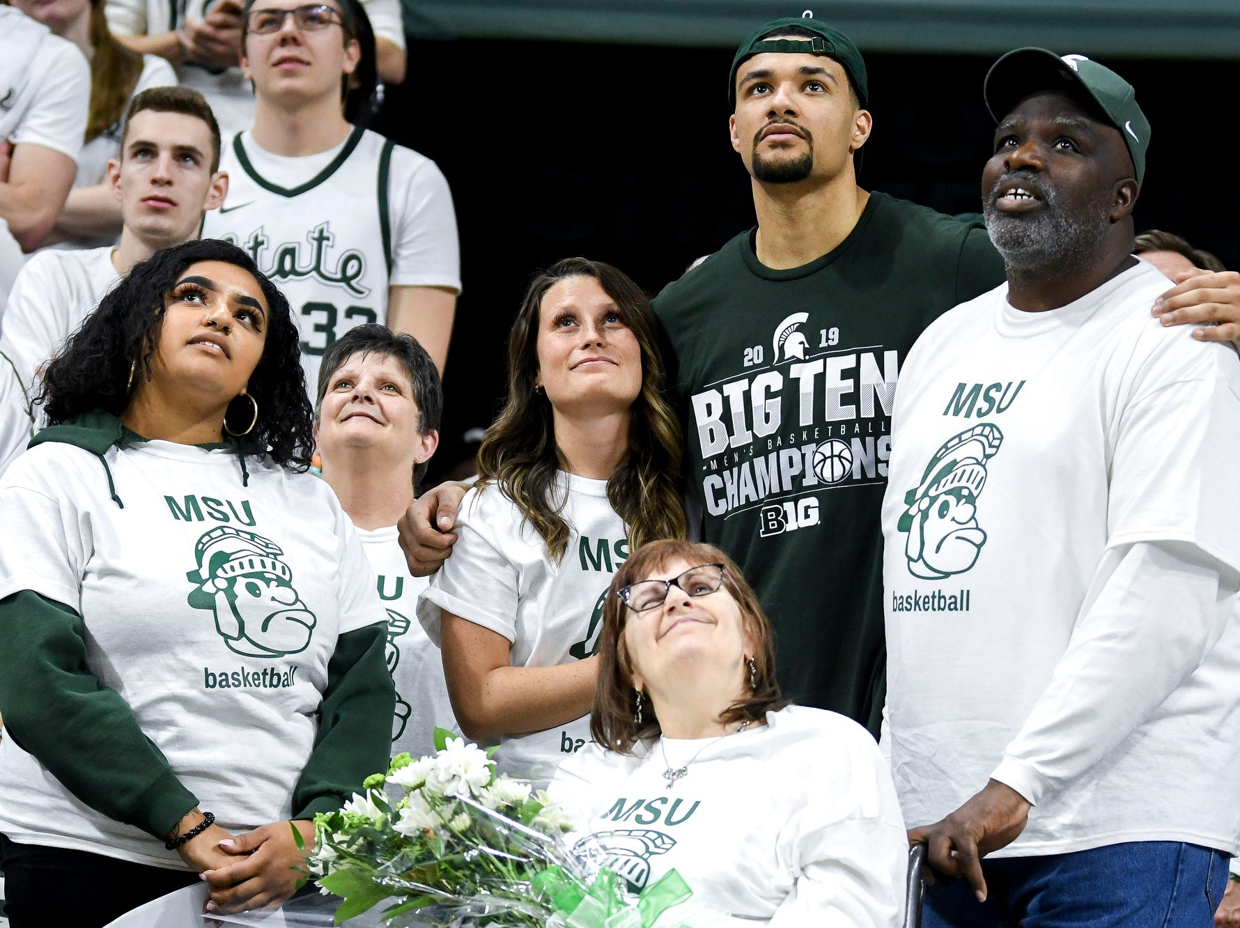 Michigan State senior Kenny Goins, center, watches a video tribute with his family during senior night after the Spartans beat Michigan 75-63 on Saturday, March 9, 2019, at the Breslin Center in East Lansing.