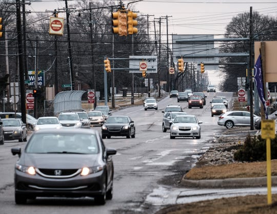 Four lanes of east-bound motorists on Saginaw vie for the lanes they need in the Frandor area Sunday, March 10, 2019.