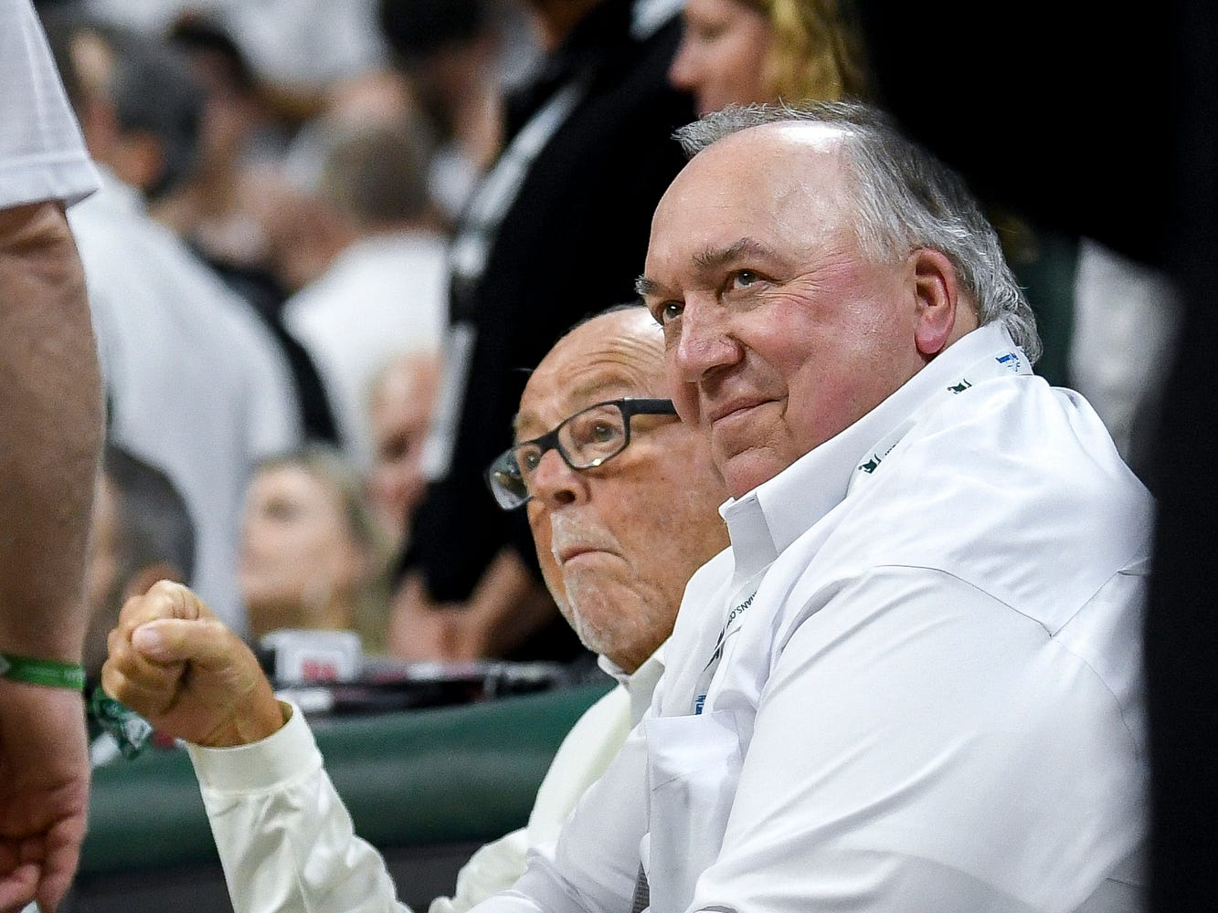 Former Michigan governor and former MSU interim president John Engler, right, and Peter F. Secchia watch the game court side during the second half on Saturday, March 9, 2019, at the Breslin Center in East Lansing.