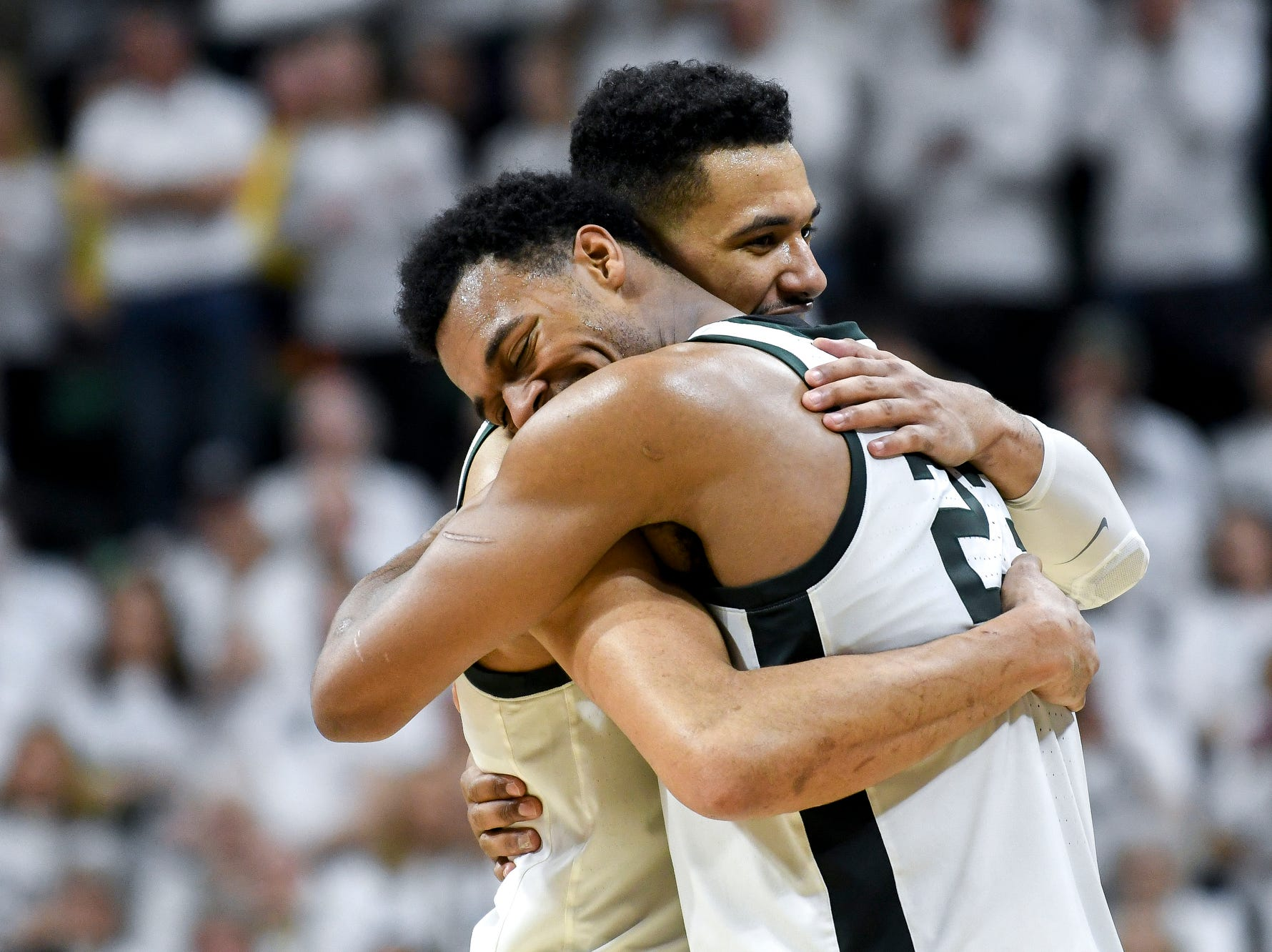 Michigan State's Xavier Tillman, right, hugs Kenny Goins during the second half on Saturday, March 9, 2019, at the Breslin Center in East Lansing.