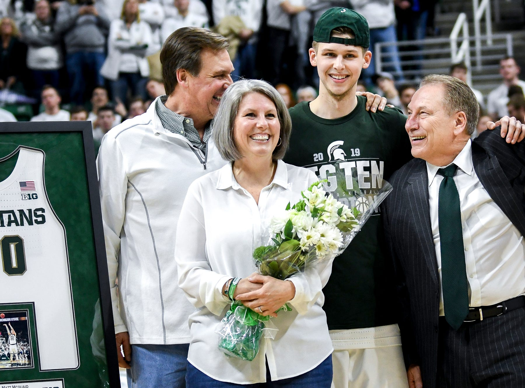 Michigan State senior Matt McQuaid and his family pose with Tom Izzo during senior night after beating Michigan on Saturday, March 9, 2019, at the Breslin Center in East Lansing.