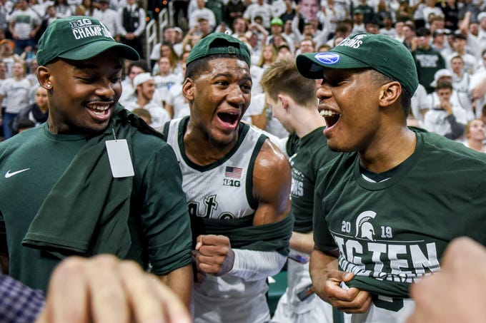 From left, Michigan State's Josh Langford, Aaron Henry and Cassius Winston celebrate beating Michigan 75-63 to win the Big Ten title on Saturday, March 9, 2019, at the Breslin Center in East Lansing.