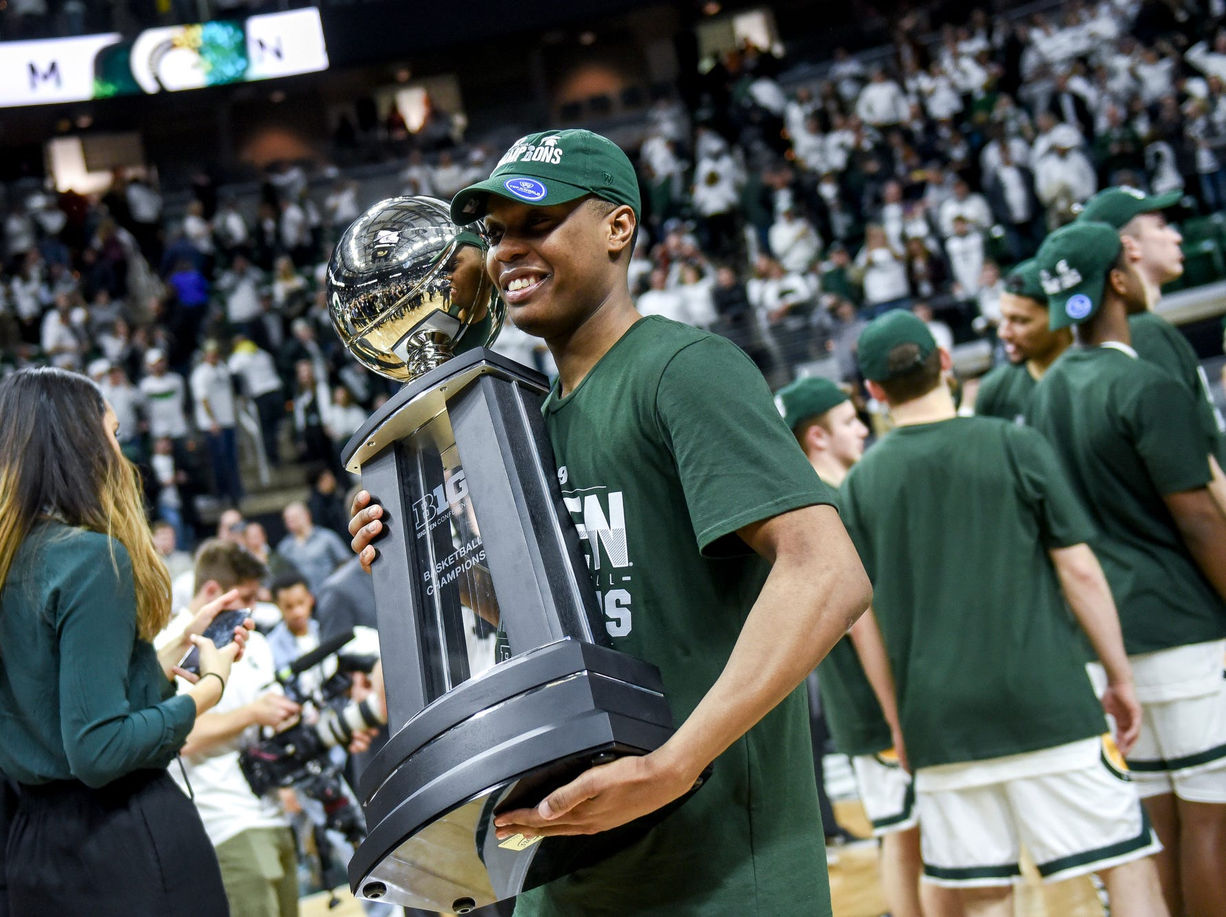 Michigan State's Cassius Winston holds the Big Ten Championship trophy after the game on Saturday, March 9, 2019, at the Breslin Center in East Lansing.