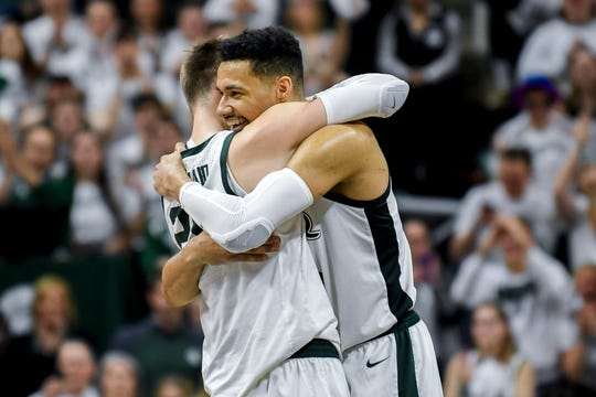 Michigan State's Kenny Goins, right, hugs Matt McQuaid during the second half on Saturday, March 9, 2019, at the Breslin Center in East Lansing.