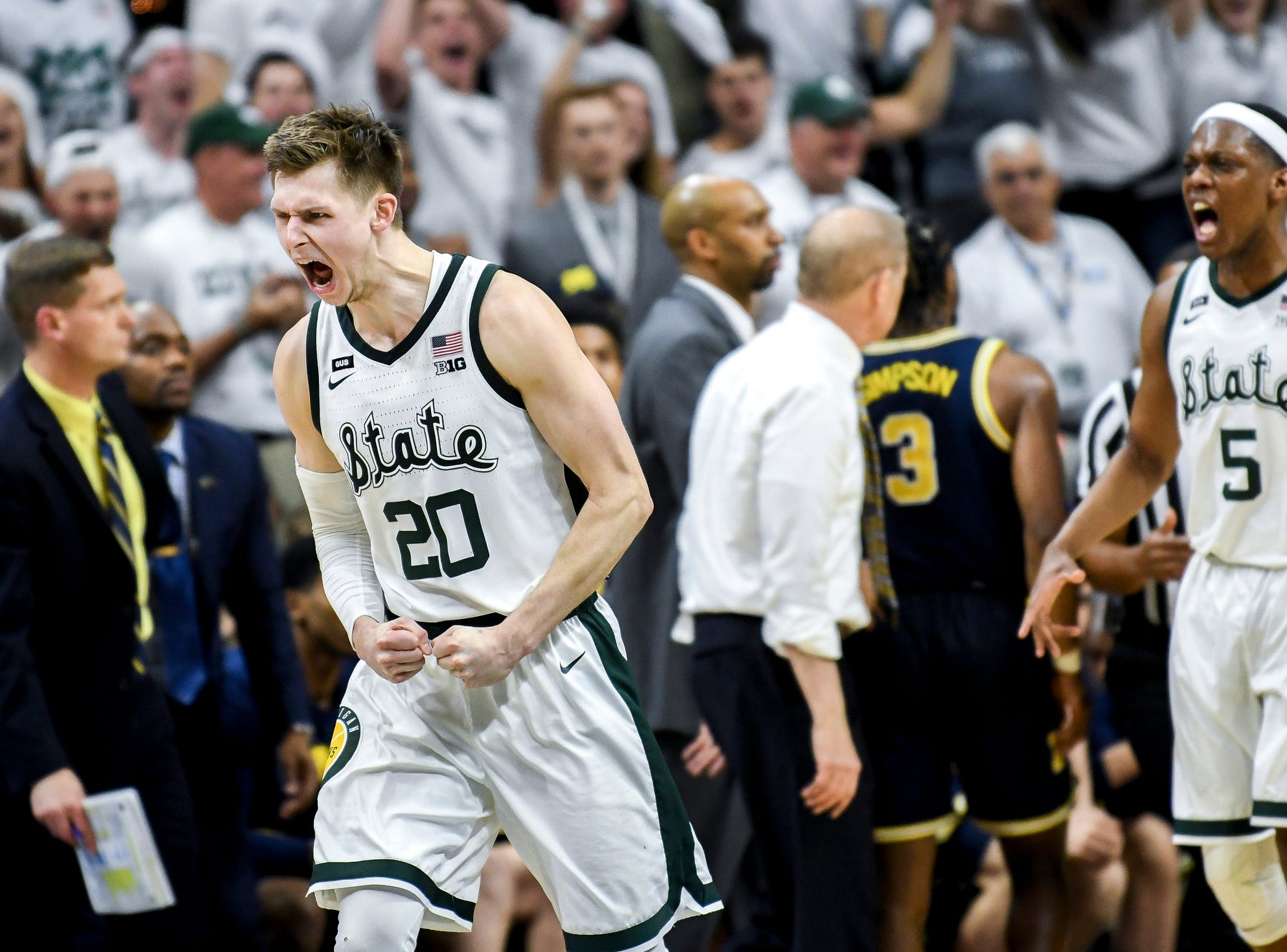 Michigan State's Matt McQuaid celebrates during a timeout  during the second half on Saturday, March 9, 2019, at the Breslin Center in East Lansing.