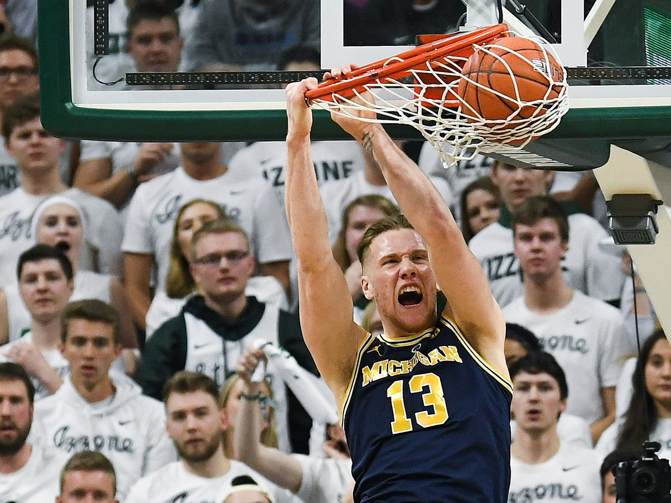 Michigan's Ignas Brazdeikis dunks during the first half on Saturday, March 9, 2019, at the Breslin Center in East Lansing.