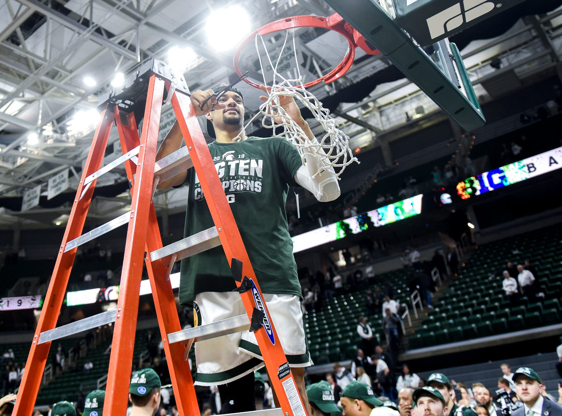 Michigan State's Kenny Goins cuts down the net after the Spartans beat Michigan 75-63 winning the Big Ten title on Saturday, March 9, 2019, at the Breslin Center in East Lansing.