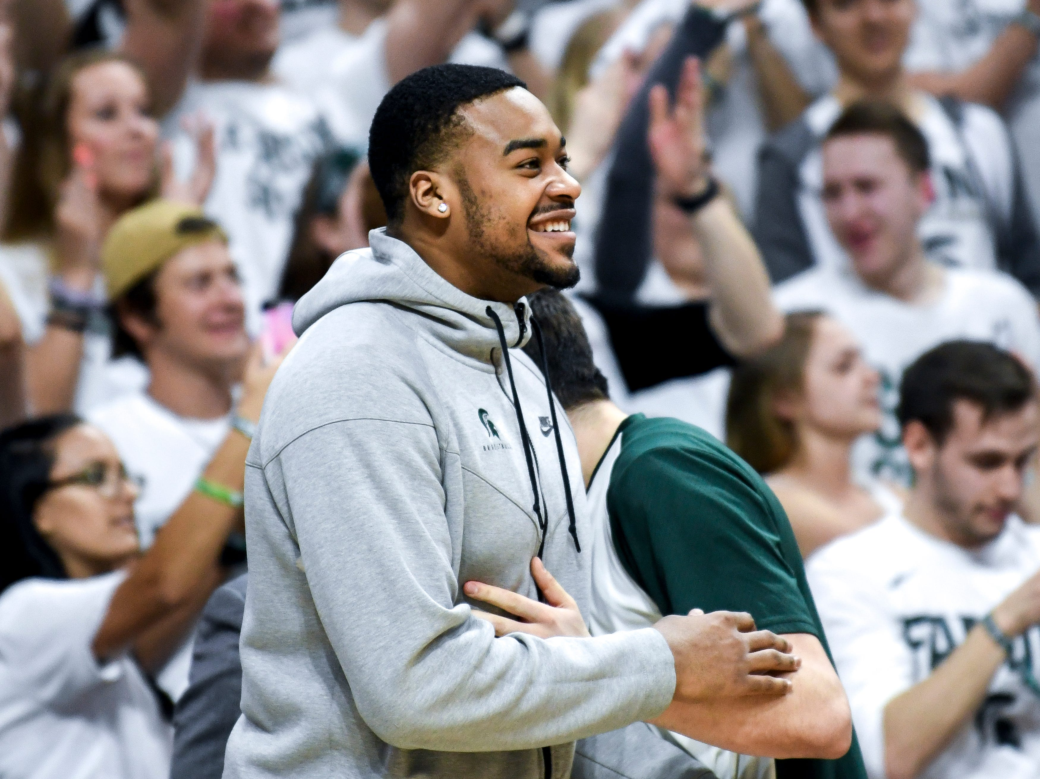 Michigan State's Nick Ward celebrates on the bench during the second half on Saturday, March 9, 2019, at the Breslin Center in East Lansing.