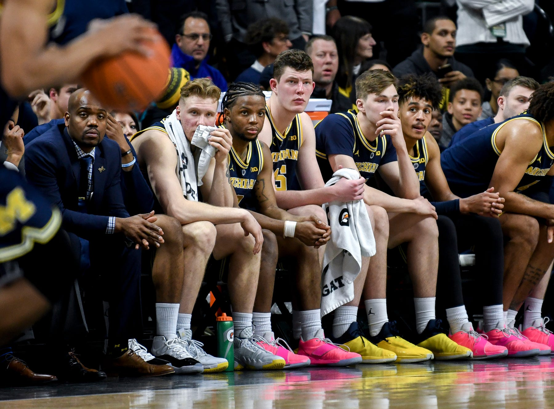 The Michigan bench looks on late during the second half on Saturday, March 9, 2019, at the Breslin Center in East Lansing.