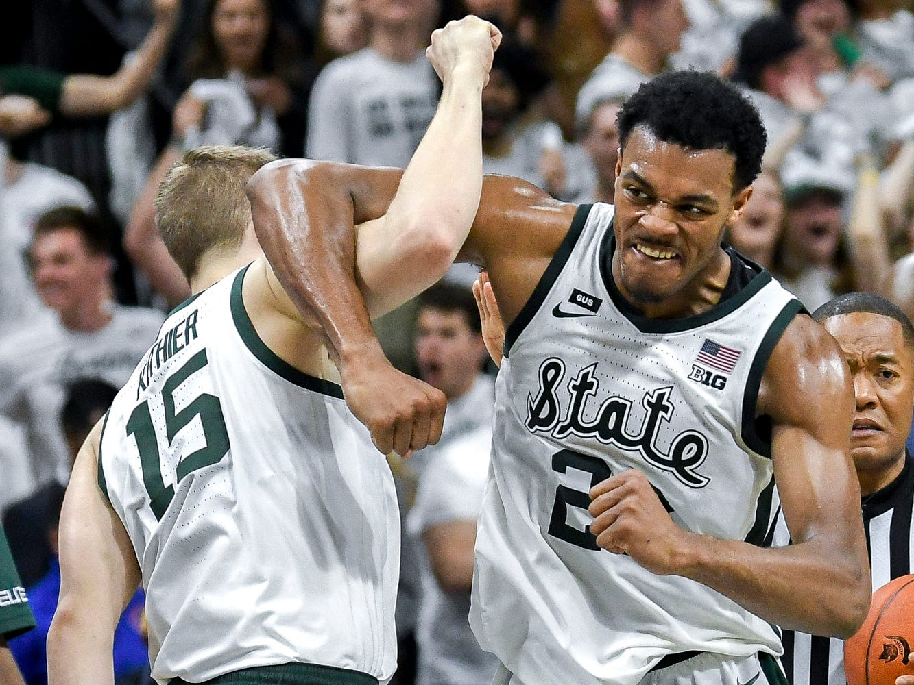 Michigan State's Xavier Tillman, right, and Thomas Kithier  celebrate during the second half on Saturday, March 9, 2019, at the Breslin Center in East Lansing.