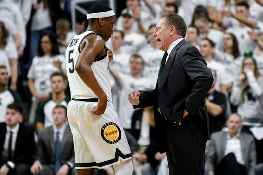 Michigan State's Cassius Winston, left, talks with head coach Tom Izzo during the first half on Saturday, March 9, 2019, at the Breslin Center in East Lansing.