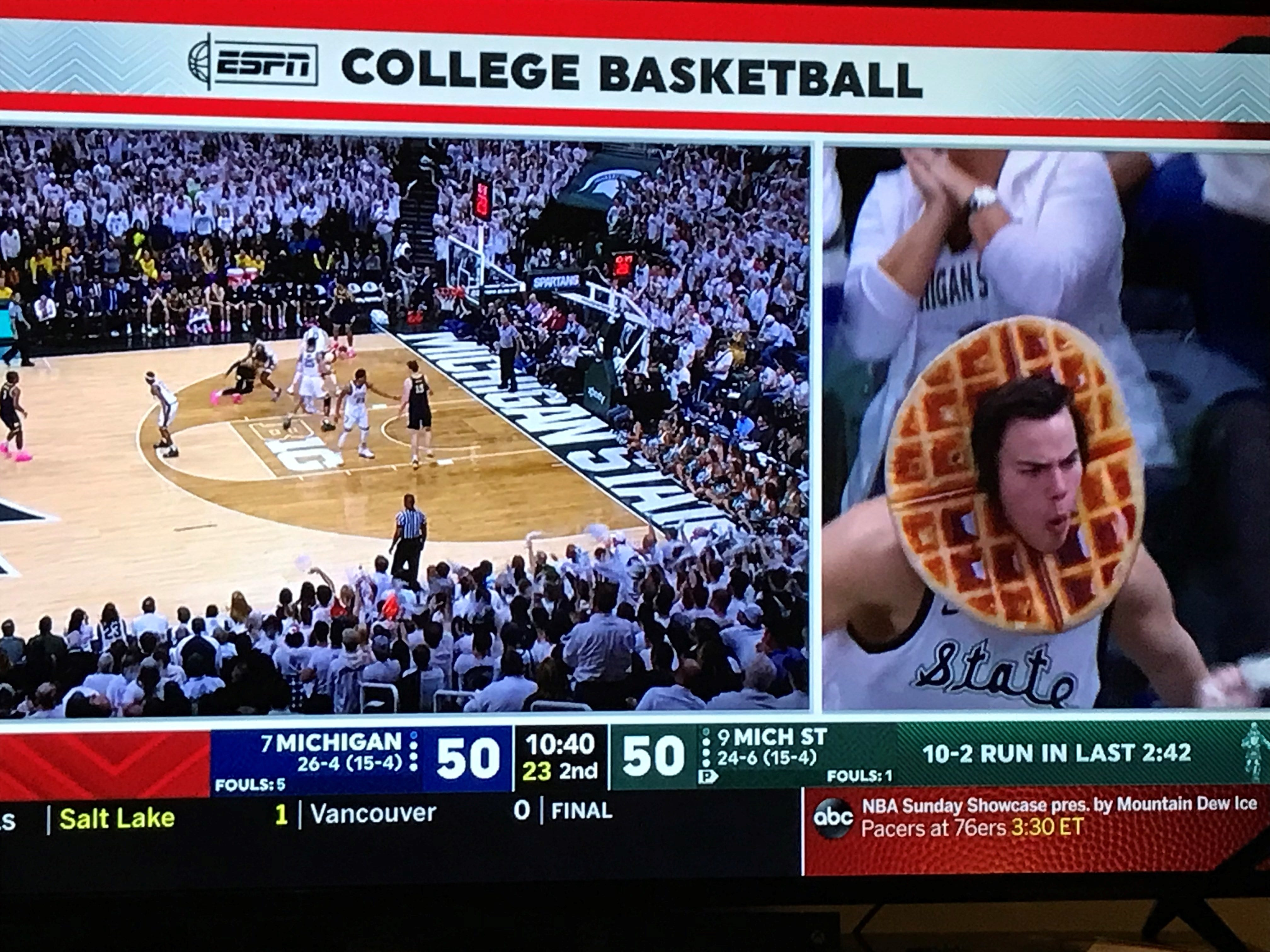 "Michigan State student Nathan ""Waffle Guy"" Guzowski got over a minute of TV time during the Spartans' Big Ten title-clinging regular season finale against Michigan in East Lansing."