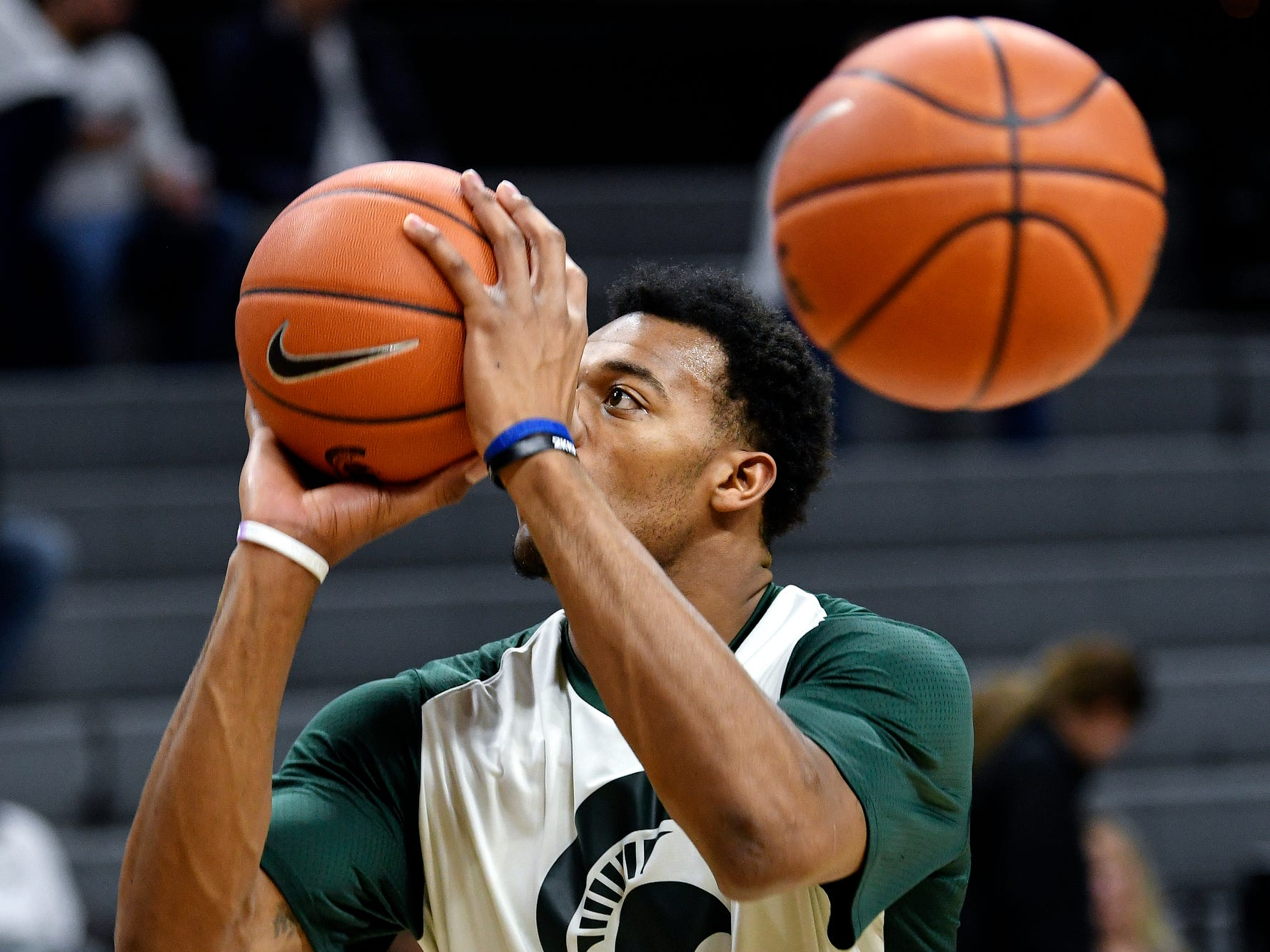 Michigan State's Xavier Tillman shoots a basket as the Spartans warm up before the game against Michigan on Saturday, March 9, 2019, at the Breslin Center in East Lansing.