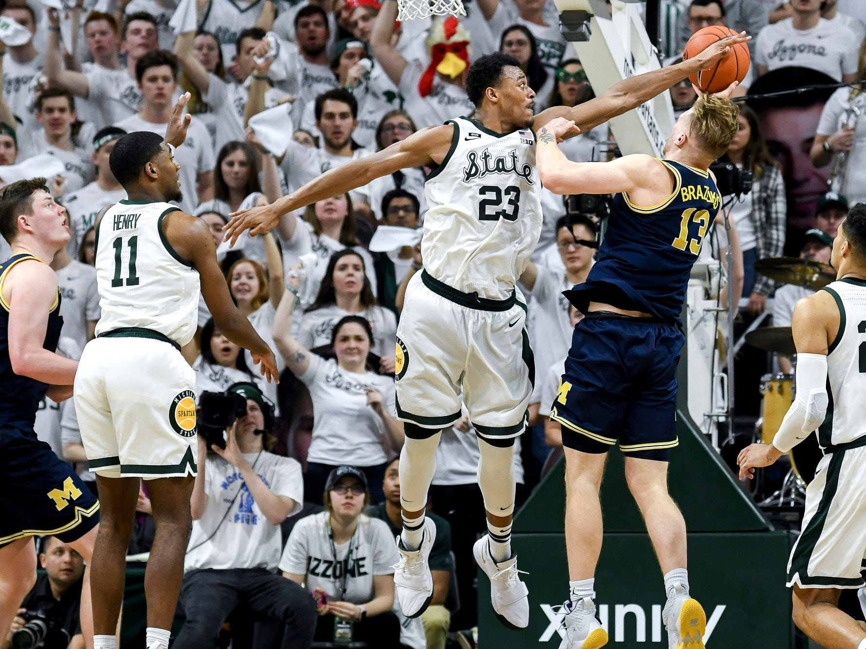 Michigan State's Xavier Tillman, left, guards Michigan's Ignas Brazdeikis during the second half on Saturday, March 9, 2019, at the Breslin Center in East Lansing.