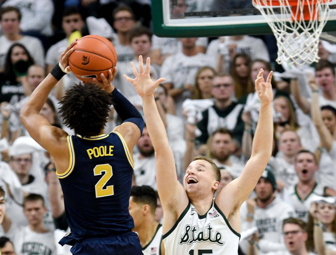 Michigan State's Thomas Kithier, right, pressures Michigan's Jordan Poole on a shot during the first half on Saturday, March 9, 2019, at the Breslin Center in East Lansing.