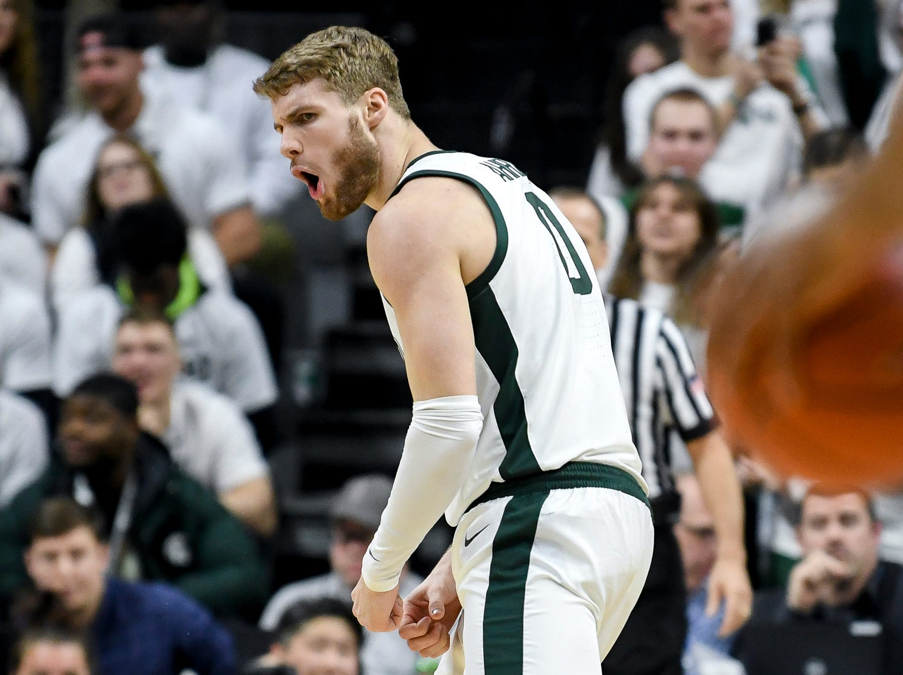 Michigan State's Kyle Ahrens celebrates after teammate Xavier Tillman's dunk during the first half on Saturday, March 9, 2019, at the Breslin Center in East Lansing.