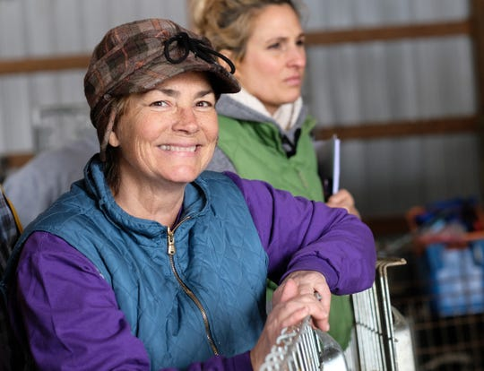 Bridget Kavanagh is all smiles as she looks over the operation of her busiest day of the year on her merino sheep farm. A crew of sheep shearers were hired to remove the wool of 50 sheep Saturday, March 9, 2019.