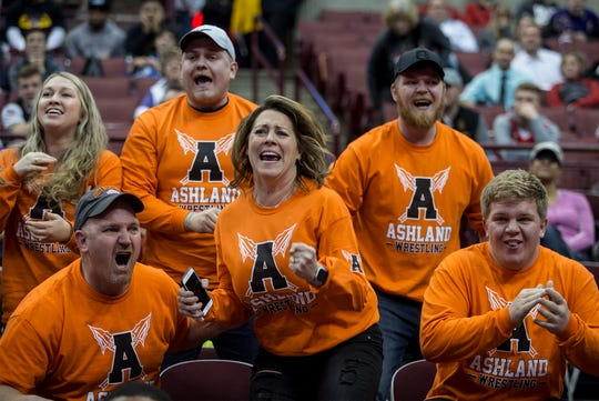 Family members of Josh Bever of Ashland cheer him onto victory during the 2019 state wrestling championships. Bever placed first in the Division I 220 weight class.
