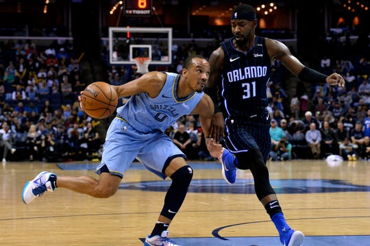 Memphis Grizzlies guard Avery Bradley (0) drives against Orlando Magic guard Terrence Ross (31) in the first half of an NBA basketball game Sunday, March 10, 2019, in Memphis, Tenn. (AP Photo/Brandon Dill)