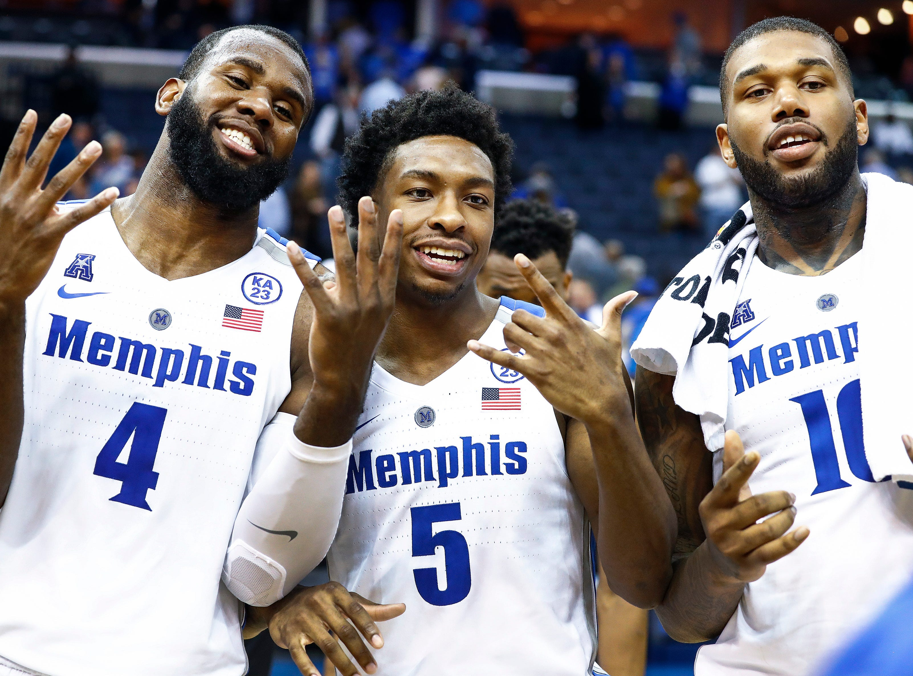 Memphis seniors (left to right) Raynere Thornton, Kareem Brewton Jr. and Mike Parks Jr. celebrate after a 66-63 victory over Tulsa at the FedExForum, Saturday, March 9, 2019.