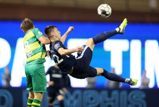 Memphis 901 FC's Wesley Charpie attempts to bicycle kick in a goal as Tampa Bay Rowdies' Zach Steinberger defends during their game at AutoZone Park on Saturday, March 9, 2019.